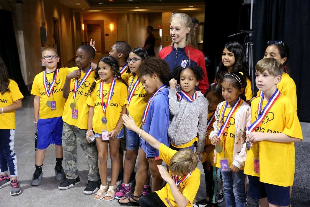Olympic athlete Bradie Tennell of U.S. Figure Skating poses with members ofRalph & Be ...