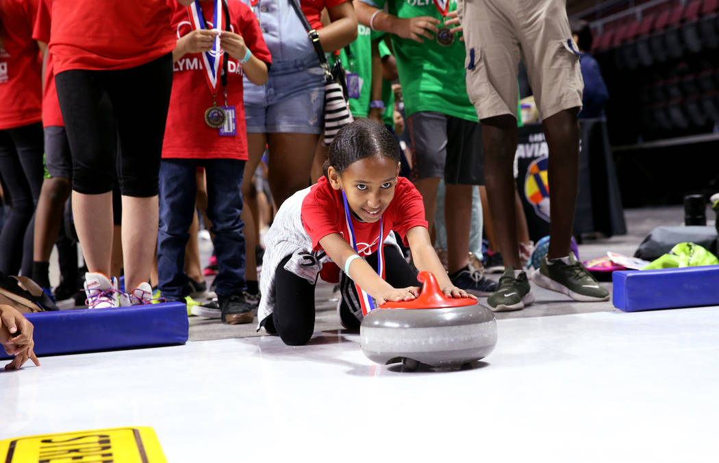 Harena Tewelde, 12, of Lied Boys & Girls Club tries curling on Olympic Day at the Orleans A ...