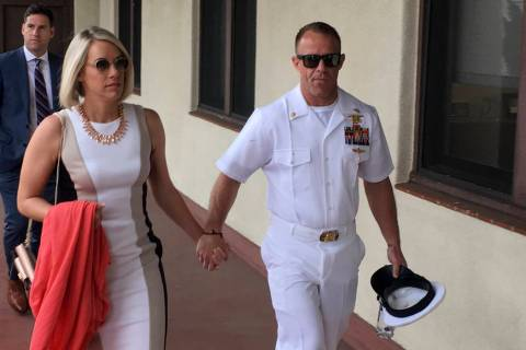 Navy Special Operations Chief Edward Gallagher, right, walks with his wife, Andrea Gallagher as ...