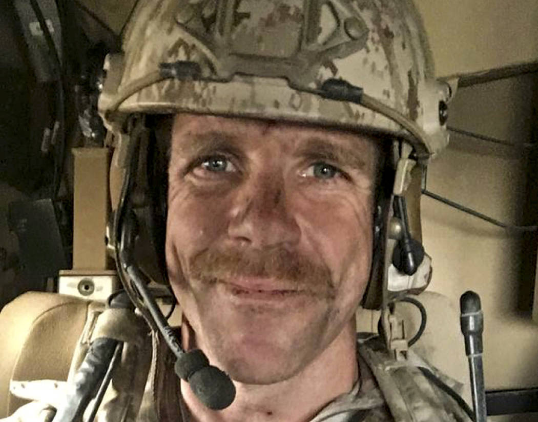 This undated selfie provided by Andrea Gallagher shows her husband, U.S. Navy SEAL Edward Galla ...