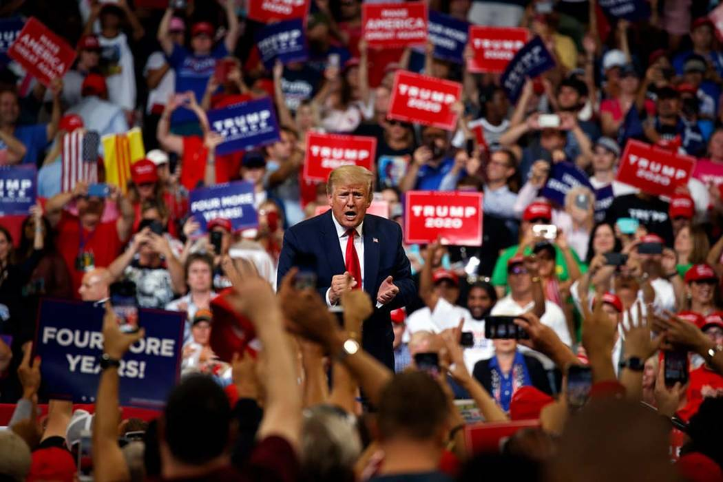 President Donald Trump reacts to the crowd after speaking during his re-election kickoff rally ...