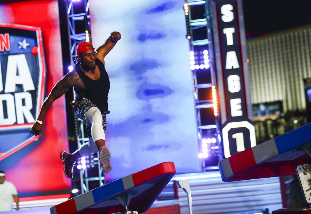 Hue Holla of Hot 97.5 attempts the first obstacle from stage one during demonstrations before t ...