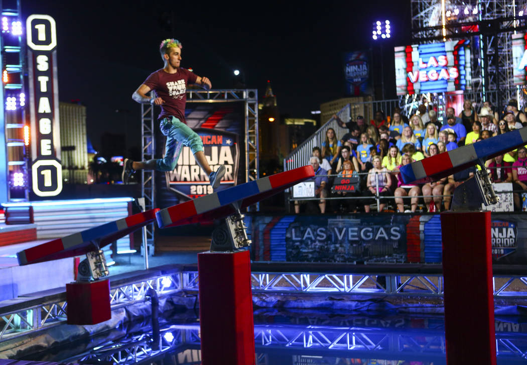 Former American Ninja Warrior competitor Austin Gray attempts the first obstacle from stage one ...
