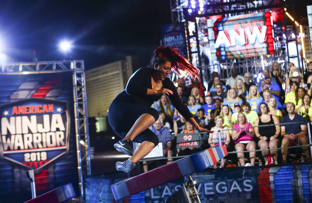 Nancy Danae of Hot 97.5 braces for impact while attempting the first obstacle from stage one du ...