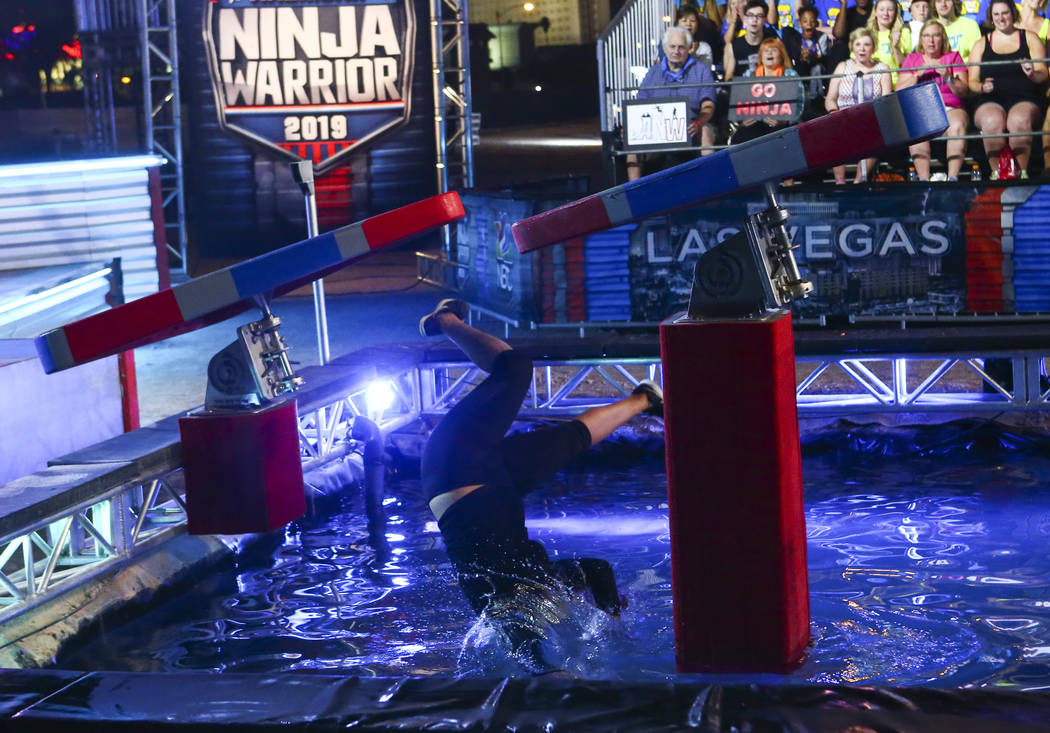 Nancy Danae of Hot 97.5 falls to the water while attempting the first obstacle from stage one d ...