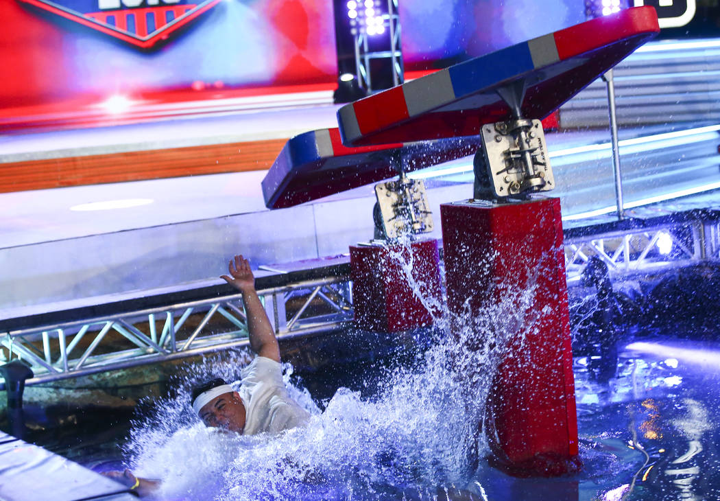 Adrian Hernandez of Hot 97.5 falls to the water while attempting the first obstacle from stage ...
