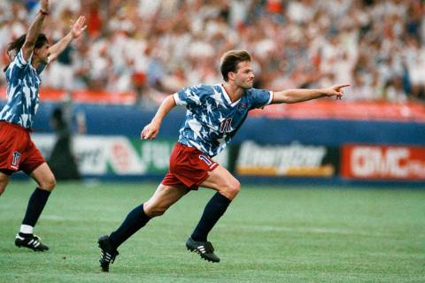 United States national team forward Eric Wynalda, right, reacts after he scored against Switzer ...