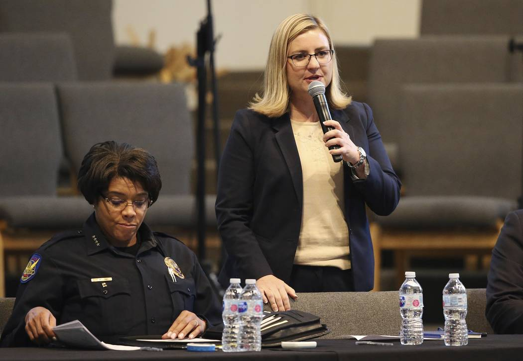 Phoenix Mayor Kate Gallego addresses the audience as Phoenix Police Chief Jeri Williams, left, ...