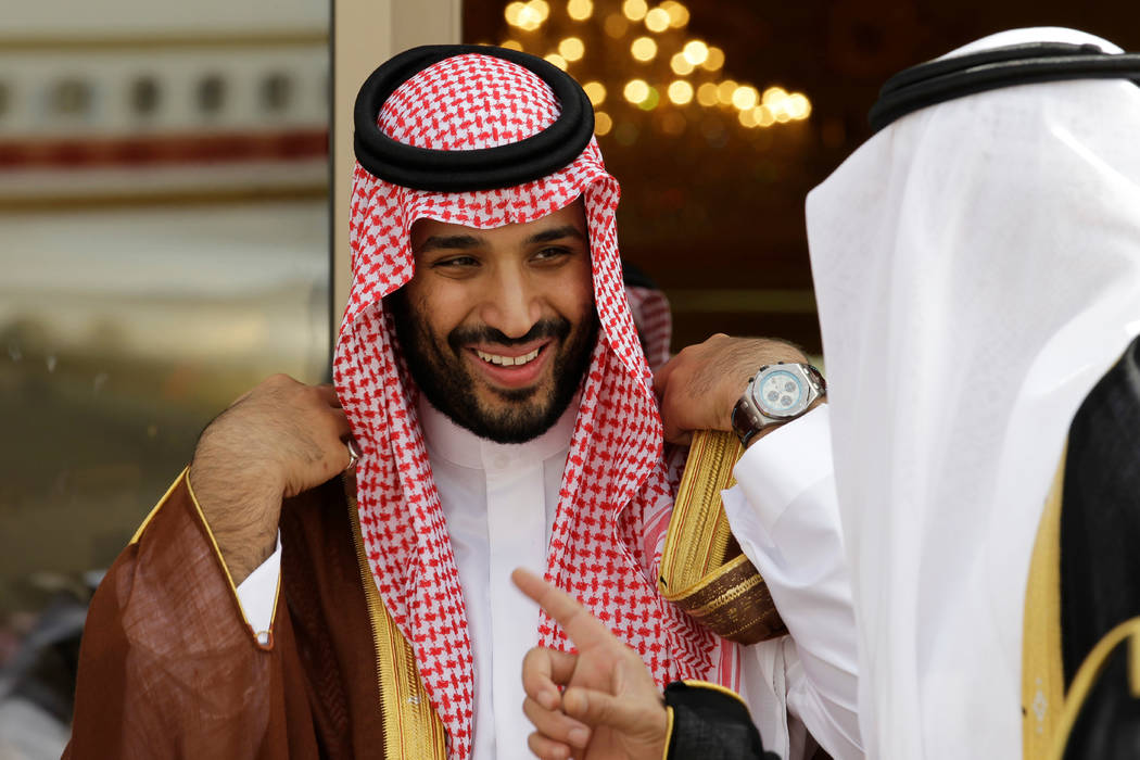In a May 14, 2012, file photo, Prince Mohammed bin Salman speaks with a Saudi prince in Riyadh, ...