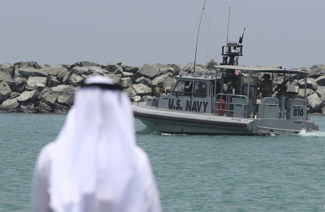 A U.S. Navy patrol boat carrying journalists to see damaged oil tankers leaves a U.S. Navy 5th ...