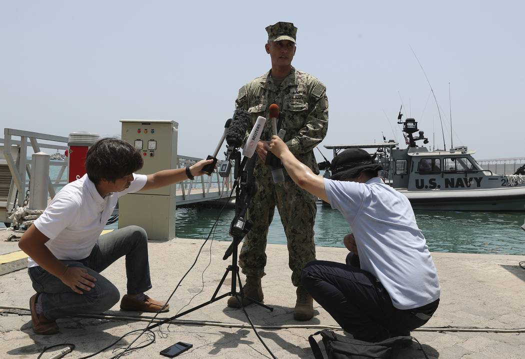 Cmdr. Sean Kido of the U.S. Navy's 5th Fleet speaks to journalists at a 5th Fleet Base, during ...