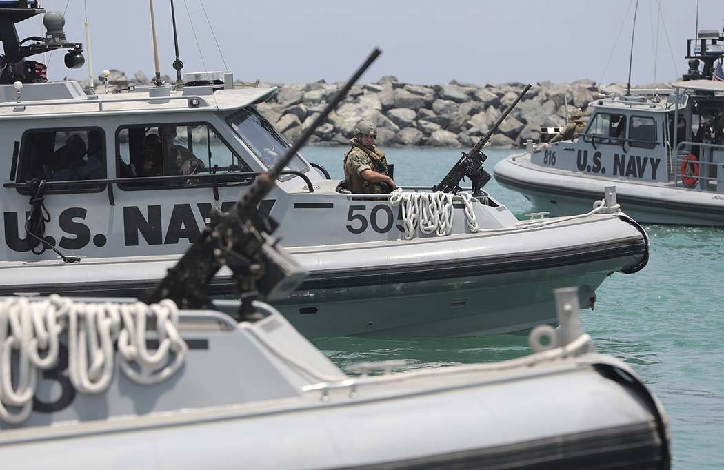 U.S. Navy patrol boats carrying journalists to see damaged oil tankers leaves a U.S. Navy 5th F ...