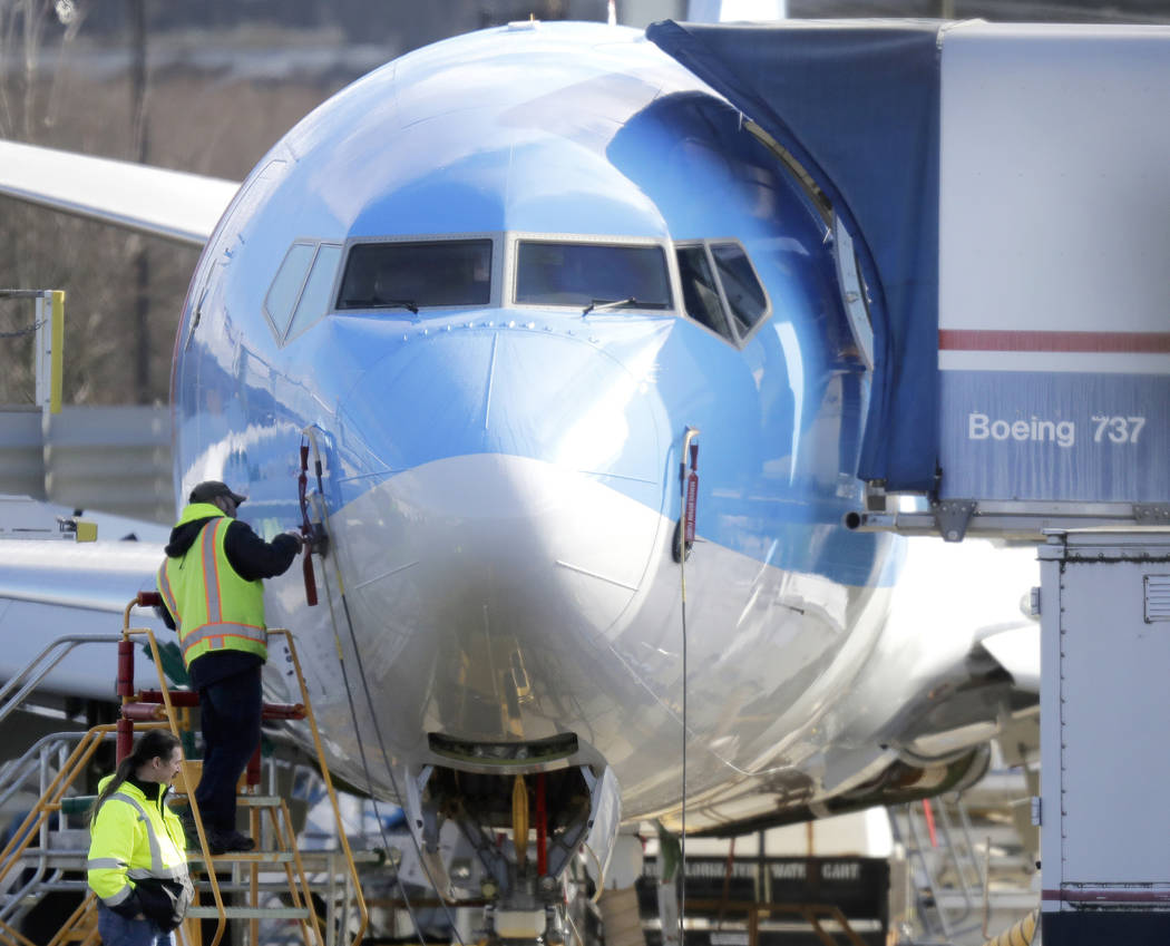 In a March 13, 2019, file photo a worker stands on a platform near a Boeing 737 MAX 8 airplane ...