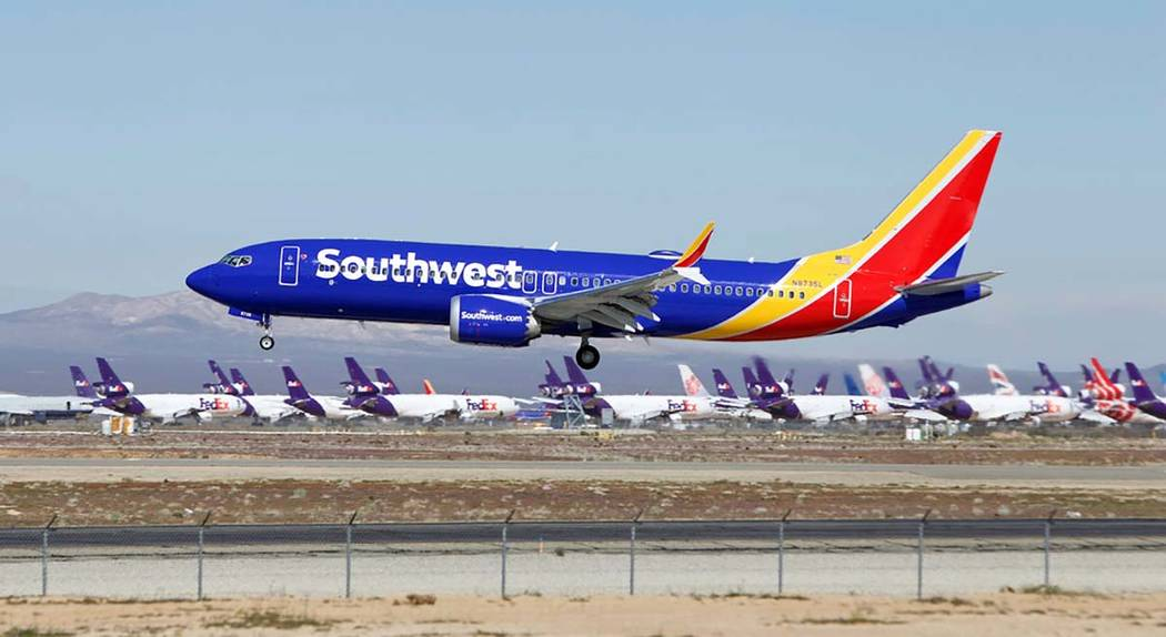 In this March 23, 2019 file photo a Southwest Airlines Boeing 737 Max aircraft lands at the Sou ...