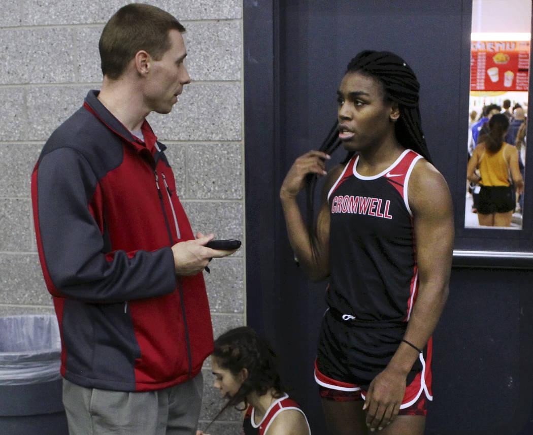 In this Feb. 7, 2019 file photo, Cromwell High School track coach Brian Calhoun, left, speaks t ...