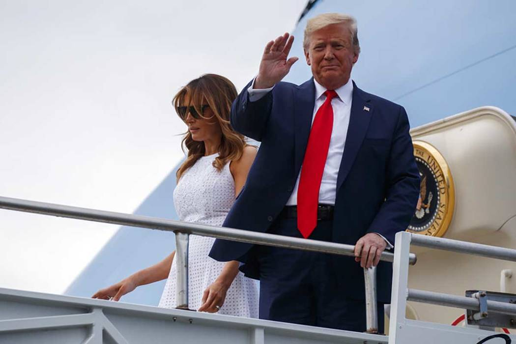 President Donald Trump and first lady Melania Trump arrive at Orlando International Airport for ...