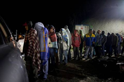 In an Aug. 31, 2018, file photo, Venezuelan migrants line up for free bread and coffee, donated ...