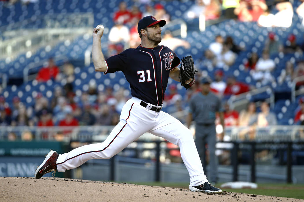 Washington Nationals starting pitcher Max Scherzer throws to an Arizona Diamondbacks batter dur ...