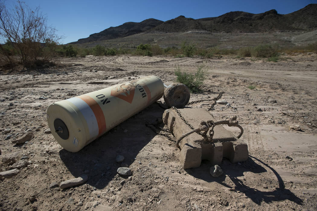 A buoy is seen high and dry near the defunct Echo Bay Marina at Lake Mead National Recreation o ...