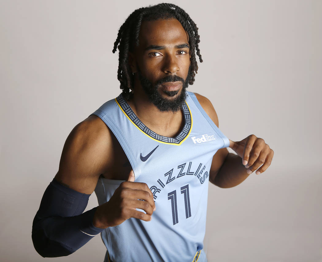 In this Sept. 24, 2018, file photo, Memphis Grizzlies guard Mike Conley poses during the team's ...