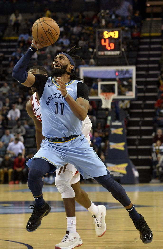 In this Feb. 27, 2019, file photo, Memphis Grizzlies guard Mike Conley (11) shoots the ball in ...