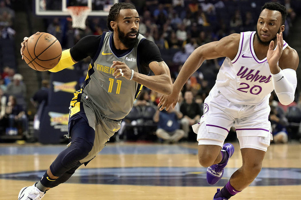 In this March 23, 2019, file photo, Memphis Grizzlies guard Mike Conley (11) handles the ball a ...