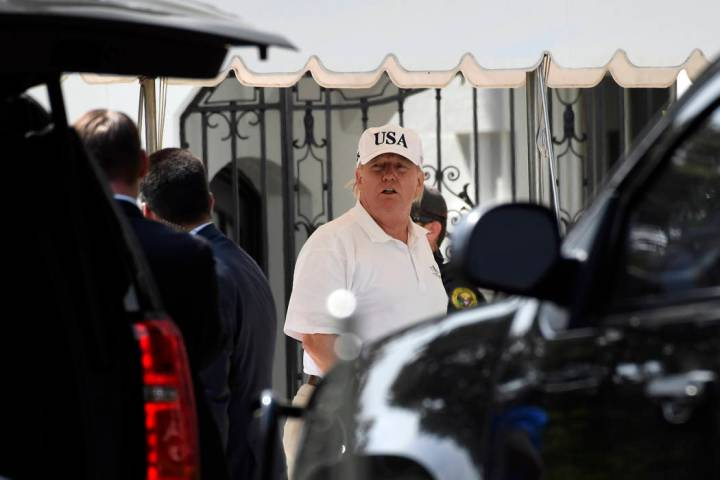 President Donald Trump gets out of his car and heads into the White House in Washington, Sunday ...