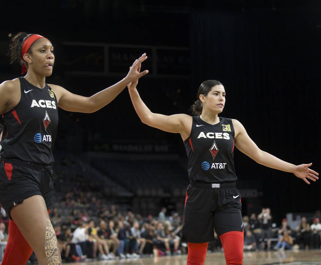 Las Vegas Aces guard Kelsey Plum (10) celebrates with Las Vegas Aces center A'ja Wilson (22) in ...