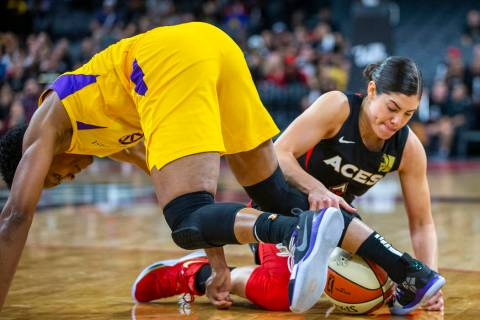 Los Angeles Sparks guard Alexis Jones, left, loses the ball to Las Vegas Aces guard Kelsey Plum ...