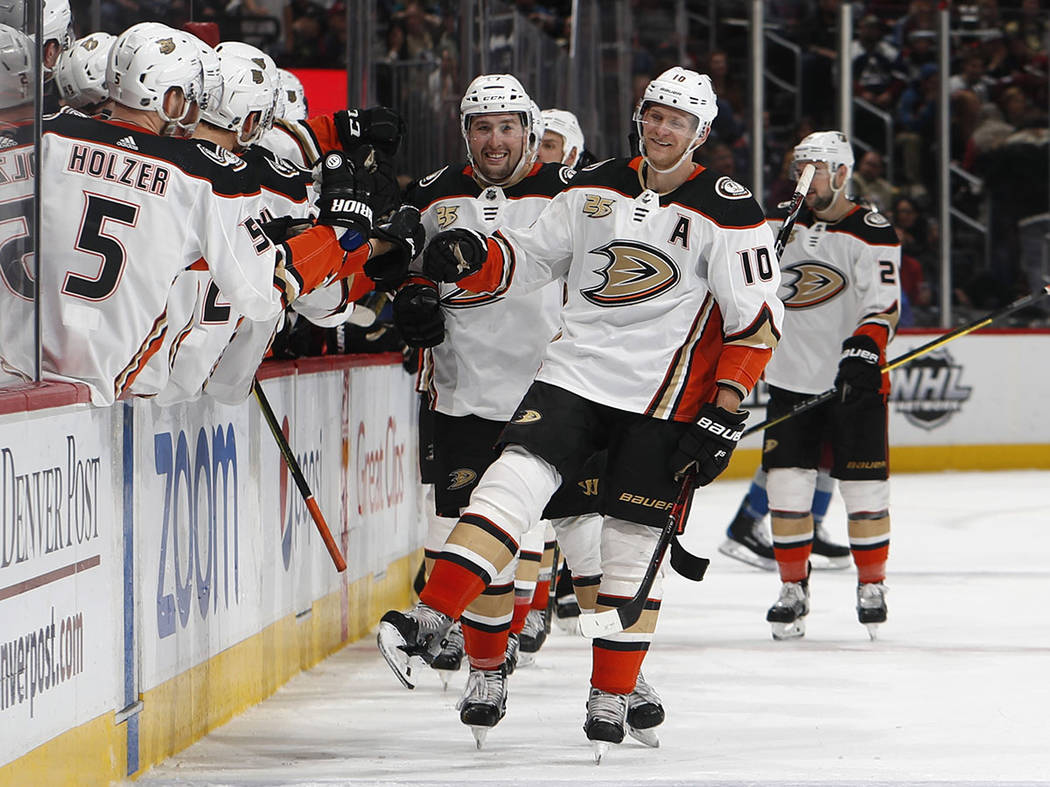 In this March 15, 2019, file photo, Anaheim Ducks right wing Corey Perry, right, is congratulat ...