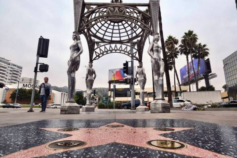 "A pedestrian walks past the ""Four Ladies of Hollywood"" gazebo on Hollywood Boulevard ..."