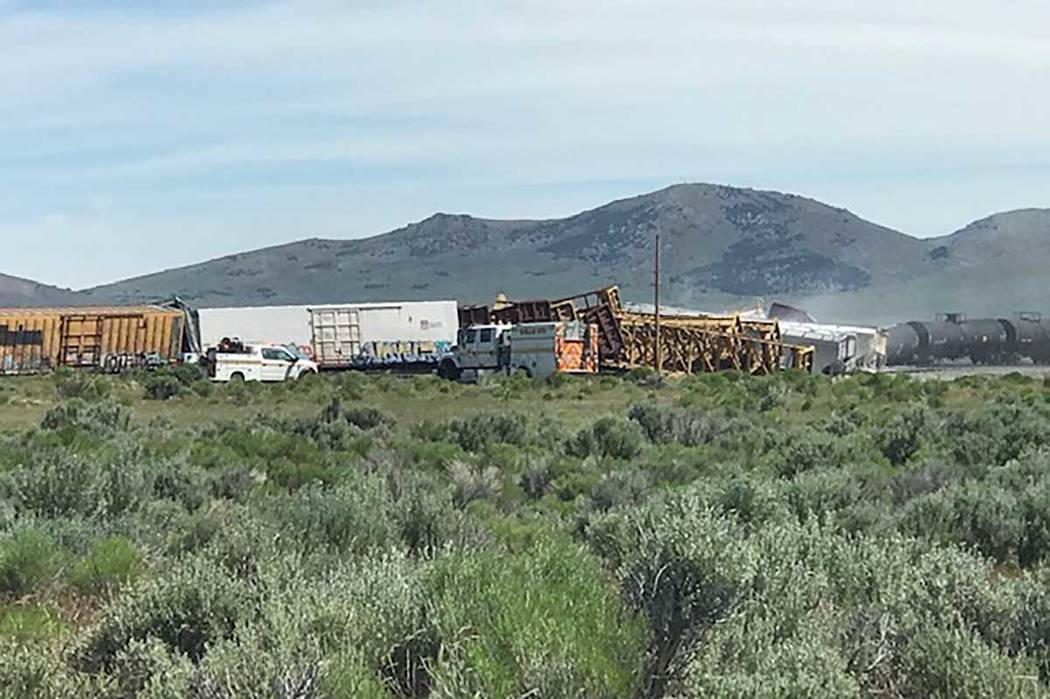 A train carrying ammunition, grenades and vegetable oil derailed Wednesday morning, June 19, 20 ...