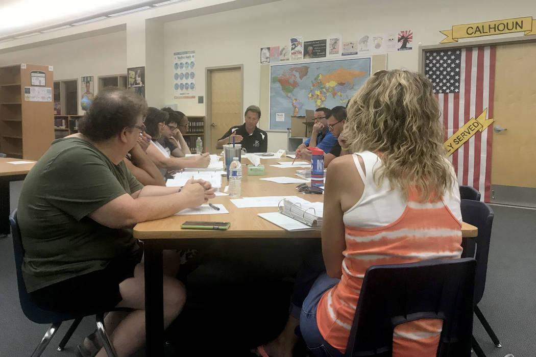 Principal James Kuzma briefs the school organizational team at Rancho High School in Las Vegas ...