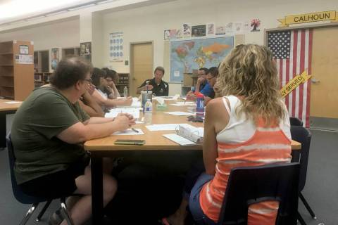 Principal James Kuzma briefs the school organizational team at Rancho High School in Las Vegas ...
