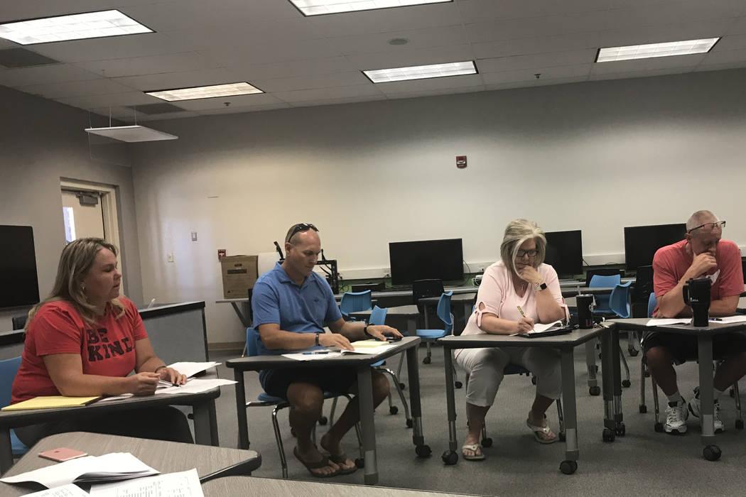 Assistant Principal Debra Berg, far left, discusses cuts with the school team at Bob Miller Mid ...