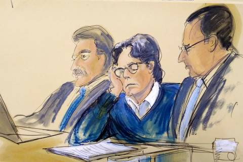 In this courtroom artist's sketch, defendant Keith Raniere, center, sits with attorneys Paul De ...