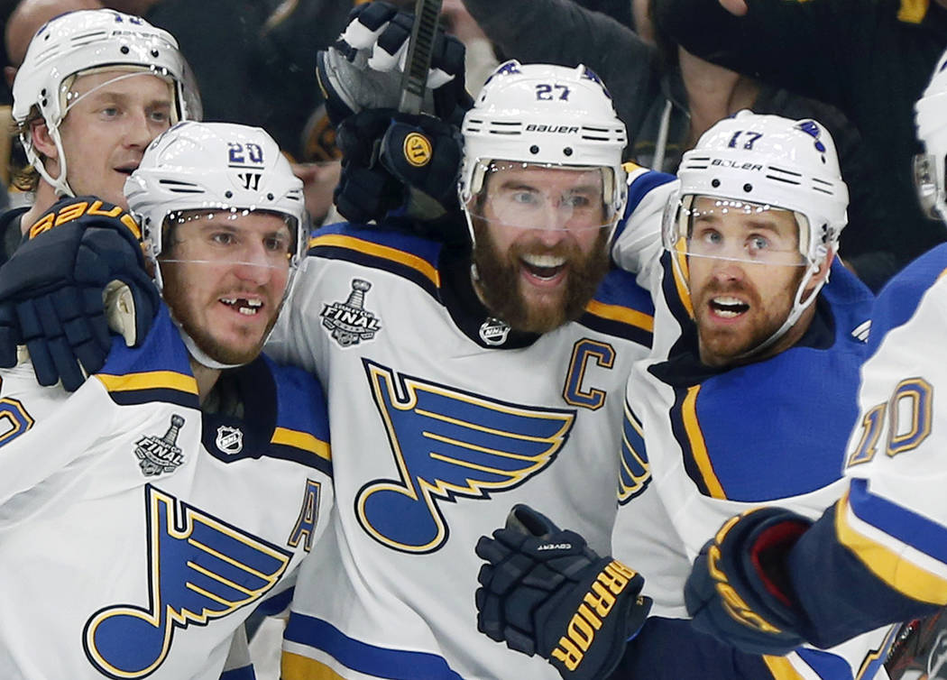 St. Louis Blues' Alex Pietrangelo, second from right, celebrates his goal with teammates Jay Bo ...