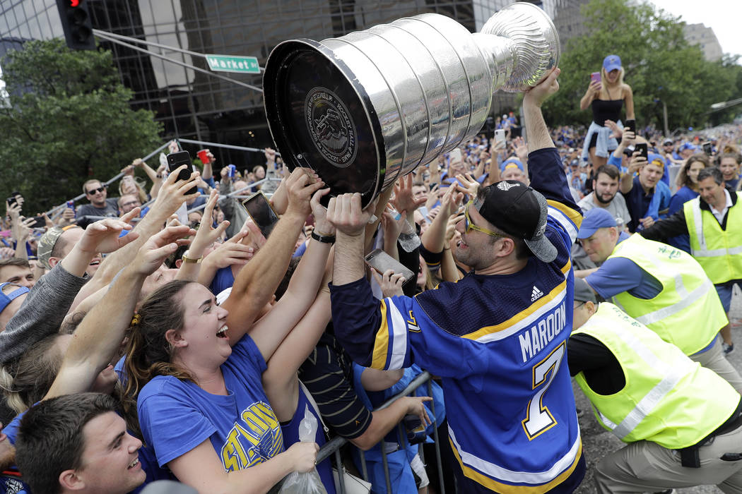 St. Louis Blues left wing Pat Maroon (7) celebrates with fans during the Blues' NHL hockey Stan ...