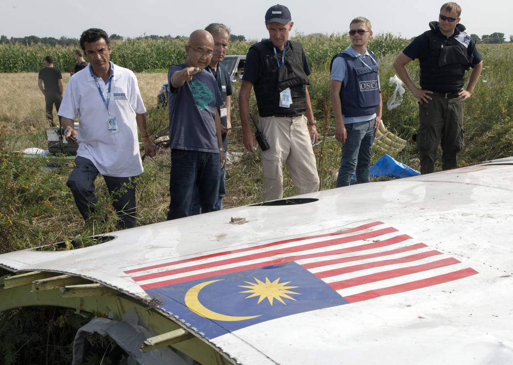 FILE In this file photo taken on Wednesday, July 23, 2014, Malaysian investigators along with m ...