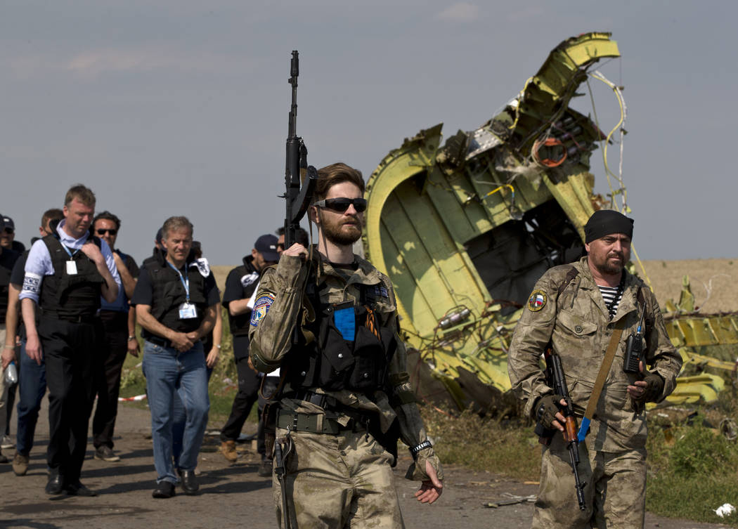 FILE In this file photo taken on Tuesday, July 22, 2014, A pro-Russian rebel holds a gun passin ...