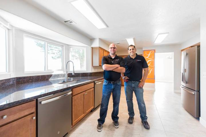 Pardee Homes Justin Zaricki, left, and Freddy Gonzales in the newly remodeled kitchen at Living ...