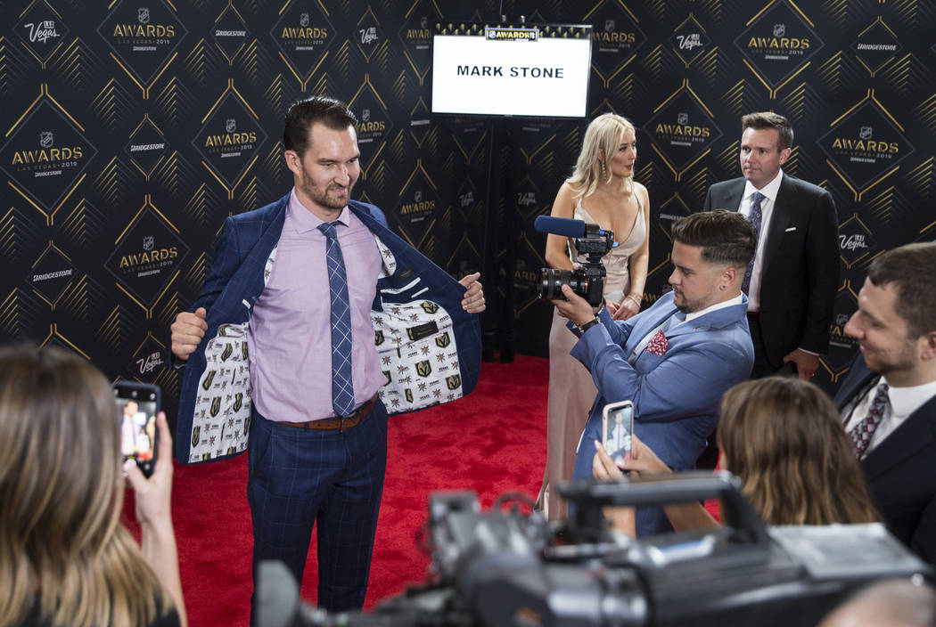 Golden Knights Mark Stone shows off his new suit on the red carpet before the start of the NHL ...