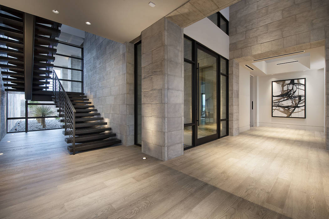 The home has two levels connected by a floating staircase. (Synergy/Sotheby's International R ...