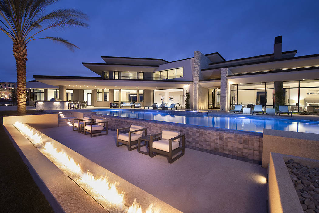 The home has a large pool area and fire features. (Synergy/Sotheby's International Realty)