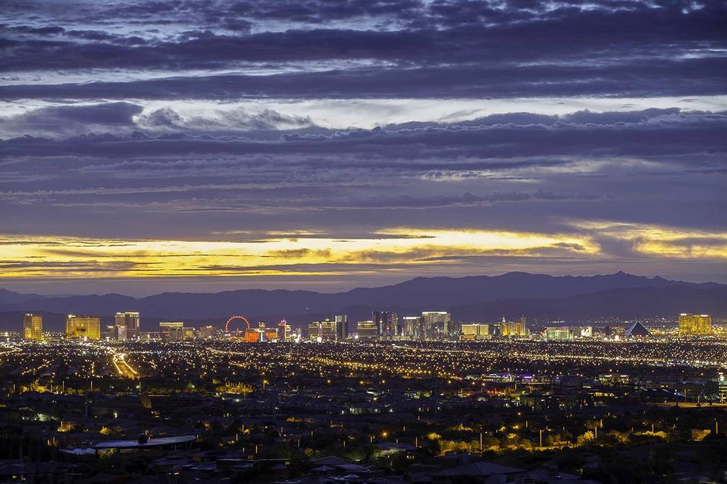 The view of the Las Vegas Strip and valley from the foothills of Summerlin underscore the commu ...