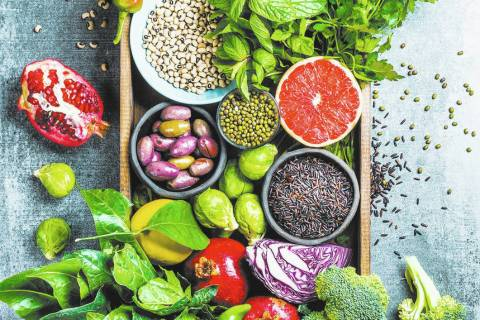 Vegetables, fruit, seeds, cereals, beans, spices, superfoods, herbs, condiment in wooden box fo ...