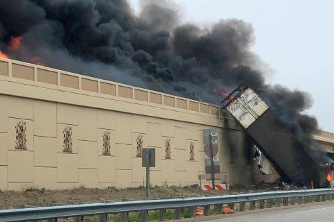 Smoke billows from a semi after a deadly crash on Interstate 94 in Caledonia, Wis., Wednesday, ...