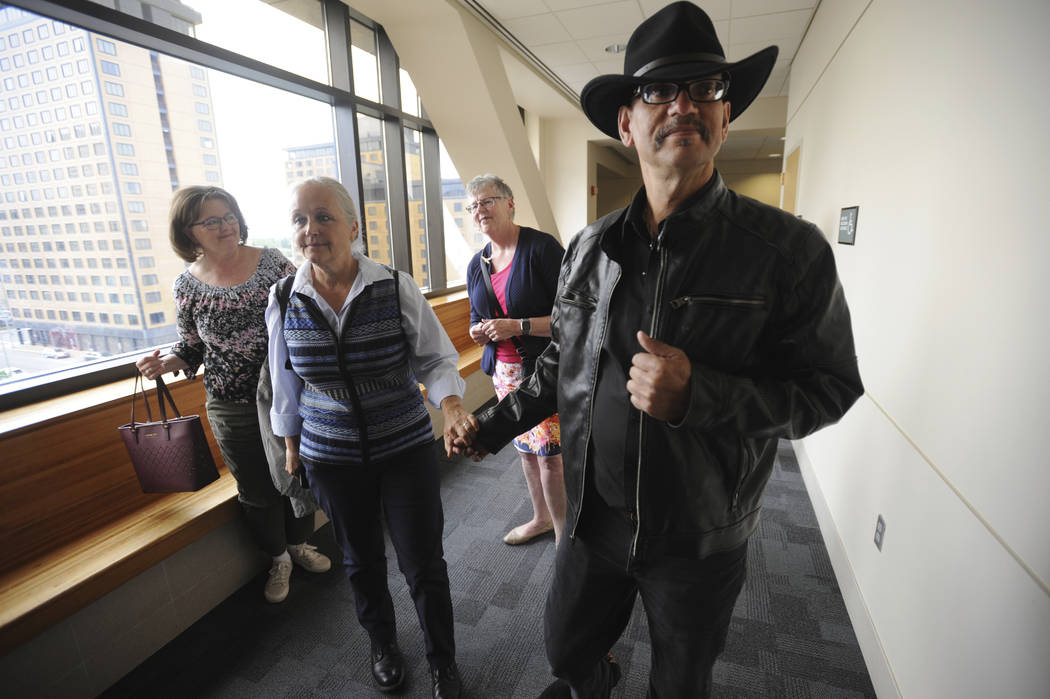 Timothy Hoffman, right, father of slain teenager Cynthia Hoffman receives support from Edie Gru ...