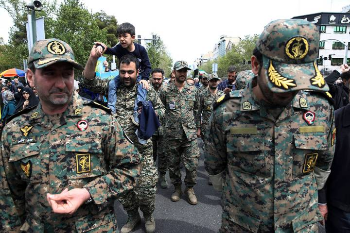 Members of the Iran's powerful Revolutionary Guards attend a rally against the U.S.'s decision ...