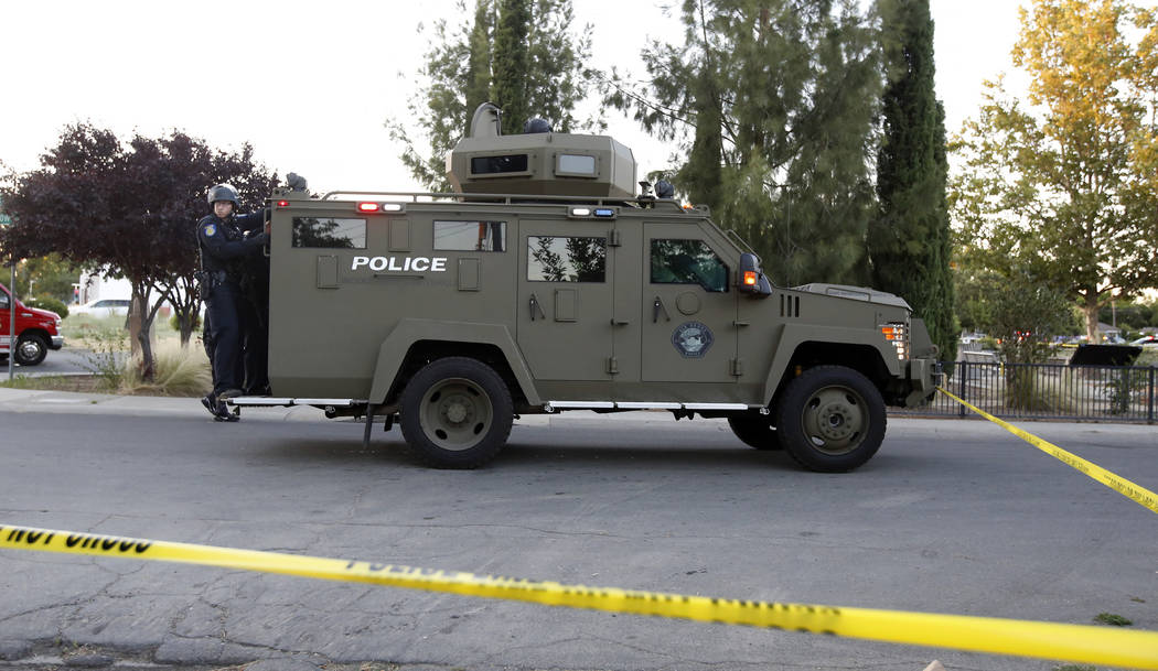 Sacramento Police officers respond to a home that authorities have surrounded where a gunman ha ...